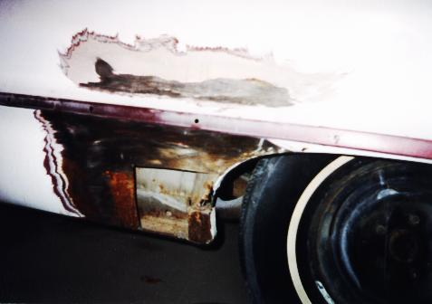 Photo showing rust cut out of quarter panel