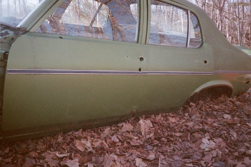 Photo of the green 4-door Nova parts car